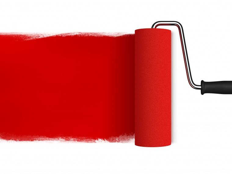 红色的油漆滚筒背景图片素材